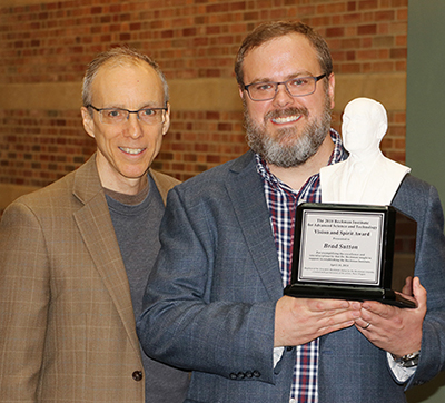 Beckman Director Jeff Moore with Brad Sutton during the award ceremony