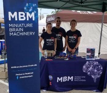 Karla Ramos-Cruz, Jorge Maldonado De-Jesus, and Lauren Gapinske at the MBM booth at the Urbana Farmer's Market, June 2019