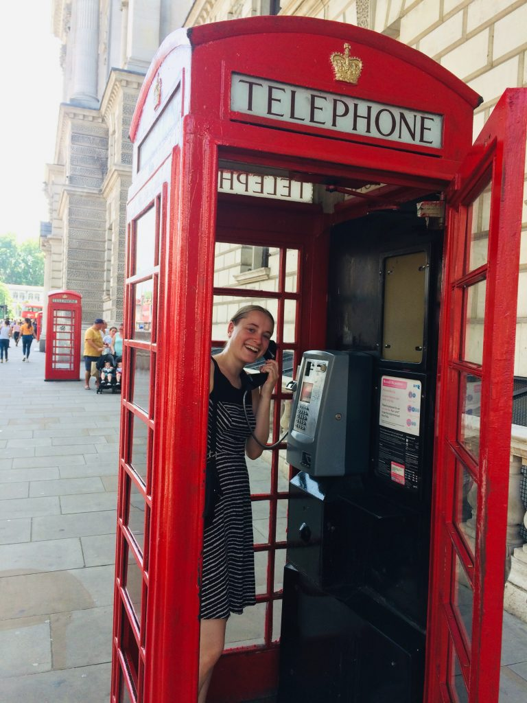 Amanda Weiss in a red telephone box in London